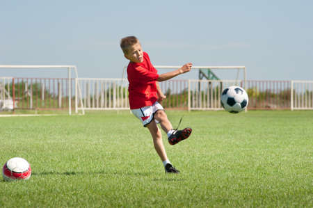 little boy kicking at goal stock photo picture and royalty free
