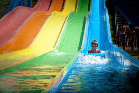 Child on water slide at aquapark photo