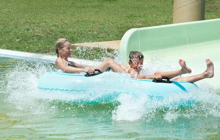 family on water slide at aquapark photo