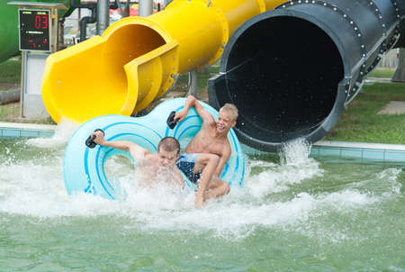 falling into water in the aquapark photo