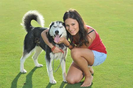 girl and her faithful husky photo