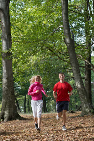 Young couple jogging in park  photo