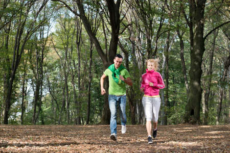 Young couple jogging in park Stock Photo - 15558248