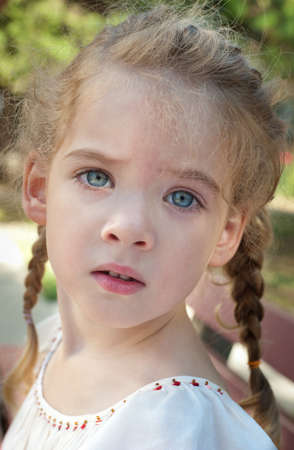 pigtail: portrait of little girl with pigtails Stock Photo