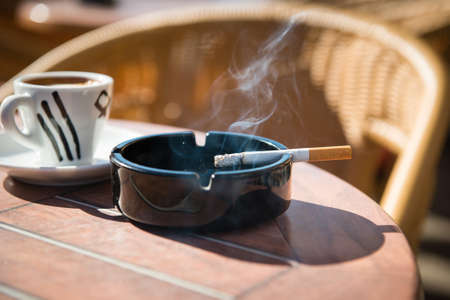 cigarette filter: burning cigarette in the ashtray   Stock Photo