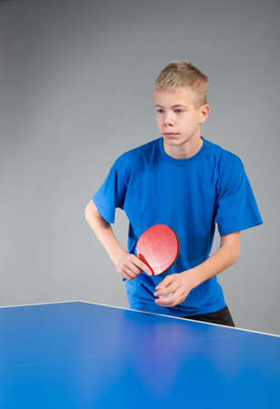 boys only: Young sportsman playing table tennis