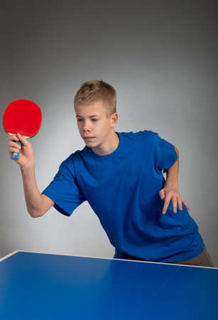 Young sportsman playing table tennis photo