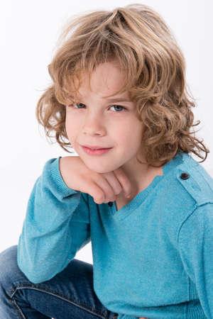 little boy in a blue sweater Stock Photo - 17382872