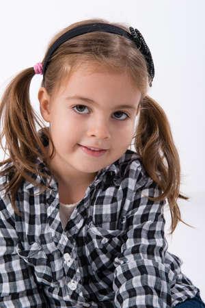 siting: little girl posing in studio Stock Photo