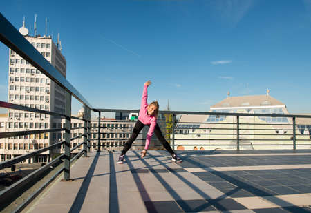 highs: young girl workout on top of the building