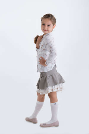 Cute girl in skirt posing Stock Photo - 17640797