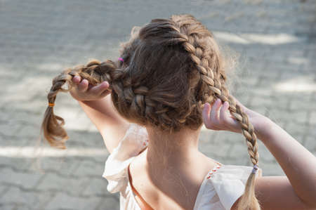 Little girl with pigtails back to us photo