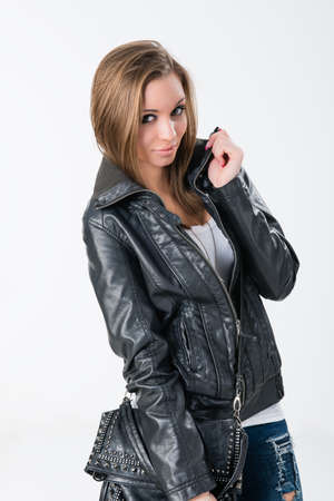 straight jacket:  young woman in black leather jacket on white background