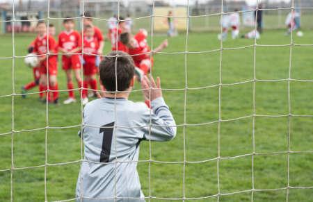 Soccer goalie in action photo