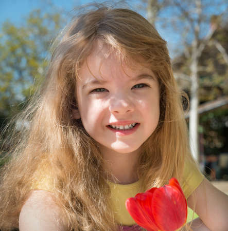 portrait of a little girl with flowers photo