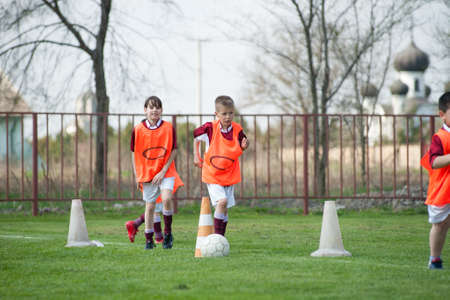 kids  soccer: Children play on the soccer field