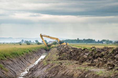 irrigation: excavator loader machine during earthmoving