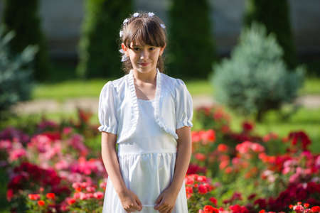 Cute Little Girl with her First Communion Dress photo