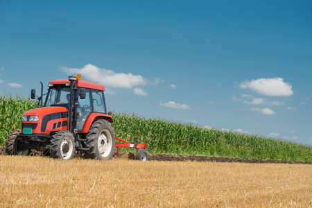 agriculture machinery: Tractor plowing the stubble field