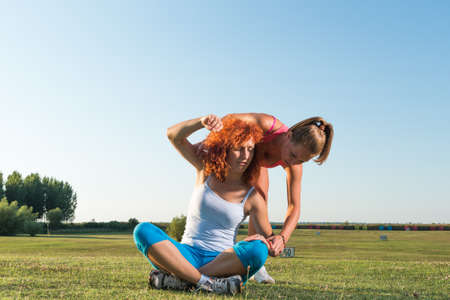 Two girls exercising in nature photo