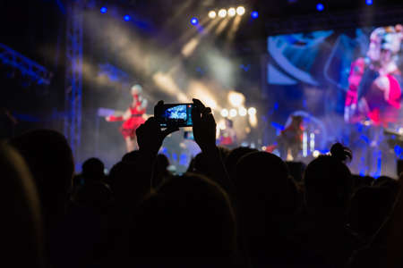 lighting effects musician: recording concert by mobile phone