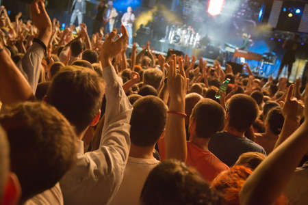 lighting effects musician: hands up on concert