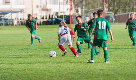 dribbling on football match photo