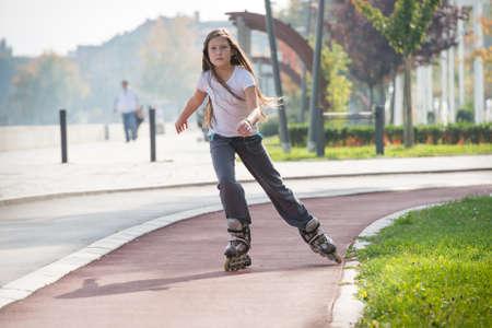 rollerblading: girl rides on roller skates