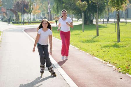 girl rides on roller skates photo