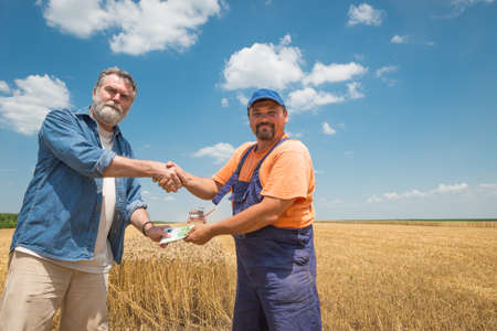 happy farmer after harvest of wheat photo