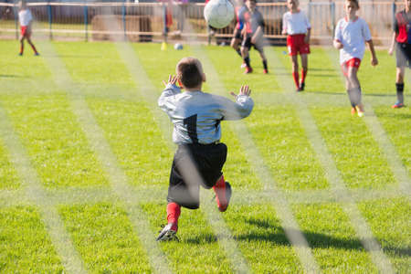 club soccer: Soccer goalie in action Stock Photo