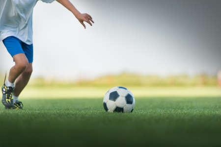 Little Boy Shooting at Goal photo