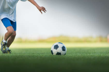 club soccer: Little Boy Shooting at Goal Stock Photo