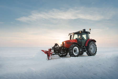 road tractor: Tractor cleaning snow in field