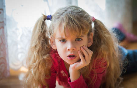 brat: portrait of angry little girl Stock Photo