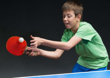 10s: young boy playing table tennis
