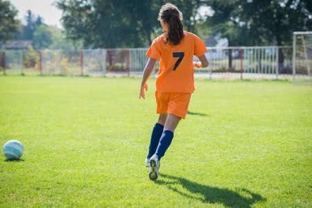 girl kick: Teen Girl soccer player is kick soccer ball Stock Photo