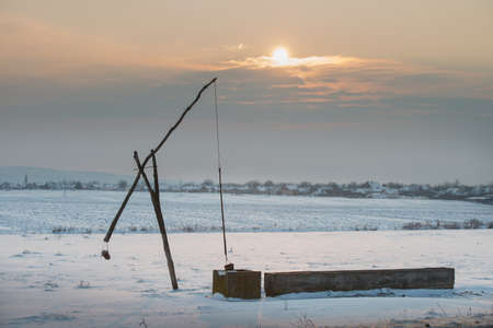 draw well: sweep of the winter field