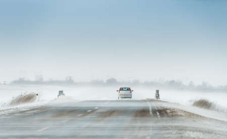 Driving car in a blizzard photo