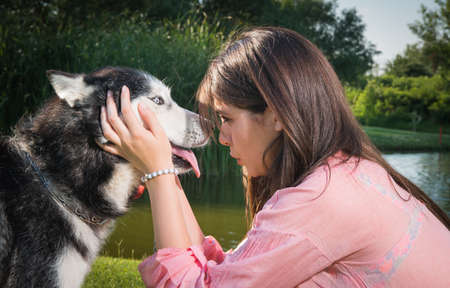 girl and her faithful husky Stock Photo