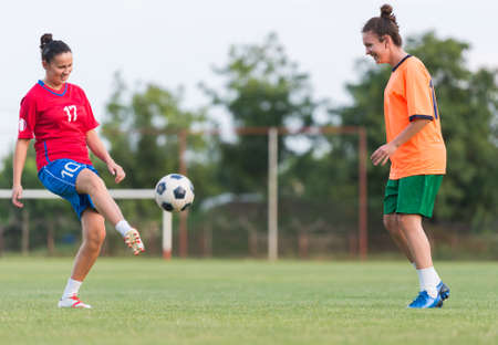 women playing soccer: Female soccer training in field Stock Photo