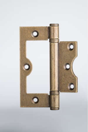 hinge: bronze hinge isolation on a white