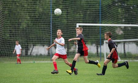 boys kicking football on the sports field photo