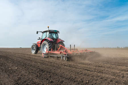 red soil: preparation of agricultural land in the spring