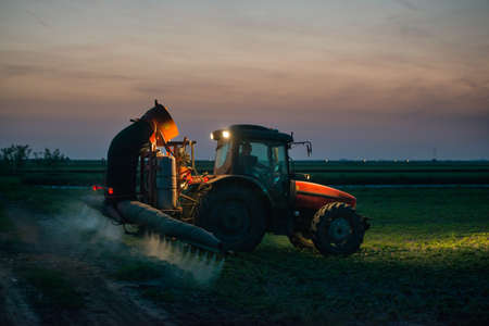 tractor spraying pesticides on soy bean Reklamní fotografie - 28636965