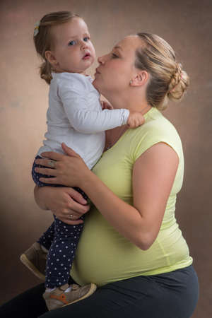 attentiveness: pregnant woman and her daughter