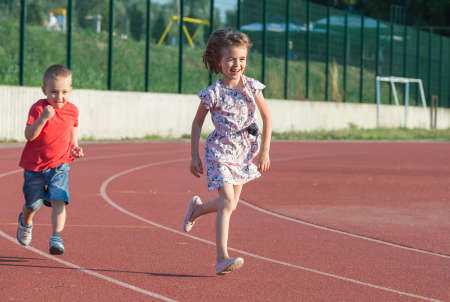 track and field athlete: children running on the track