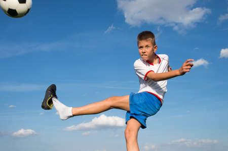 club soccer: Little Boy Shooting at Goal Stock Photo