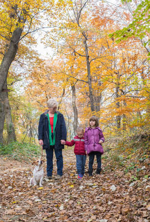 winter people: Grandmother with grandchildren on walk In forest