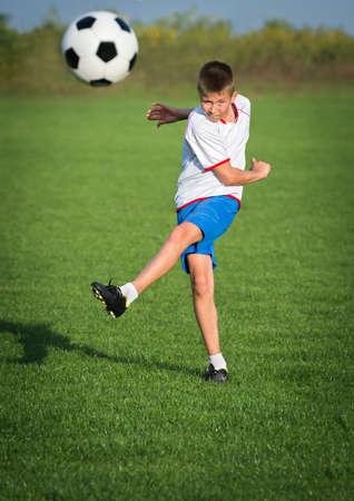 elementary age boys: Little Boy Shooting at Goal Stock Photo